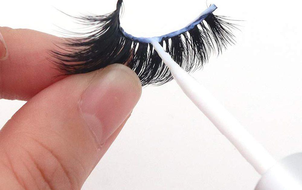 Putting Lash Adhesive on Eyelash Extension